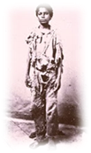 A vintage photo of a person standing posing for the camera  Description automatically generated